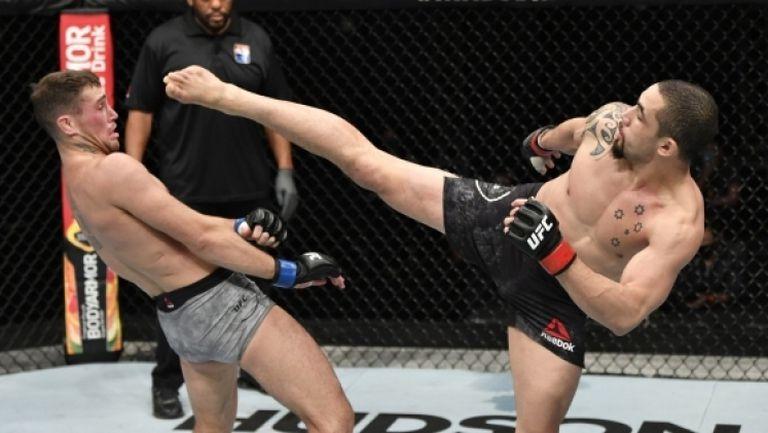 Уитакър надви Тил в оспорван сблъсък на бойния остров на UFC
