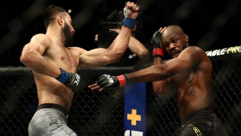 Джон Джоунс удължи легендарната си шампионска серия след сериозен тест на UFC 247